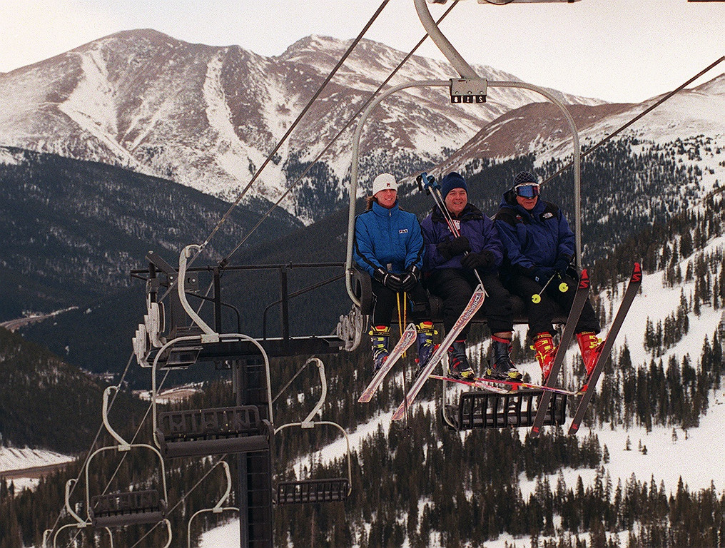 . The Annual Denver post Ski Marathon, Nowel Lyons Dean  Singleton, Post owner and Charlie Meyers on the ski lift in  Loveland Ski resort. The group was trying to ski as many Colorado  ski resorts as they could in one Day. 1997.  Glen Martin  / The Denver Post