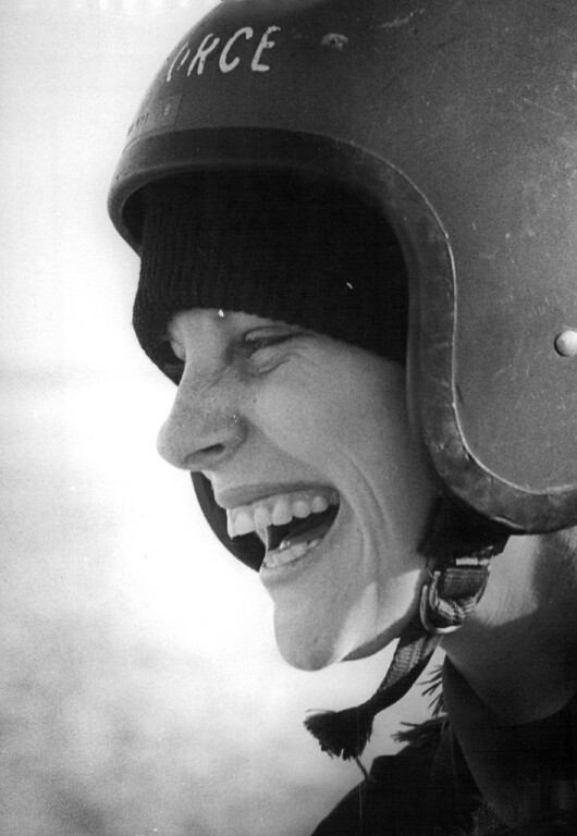 . 2nd Lt. Paula A. Gathright laughs after her ride. All of the women wanted parachute lessons to follow. 1976. The Denver Post Library Archive