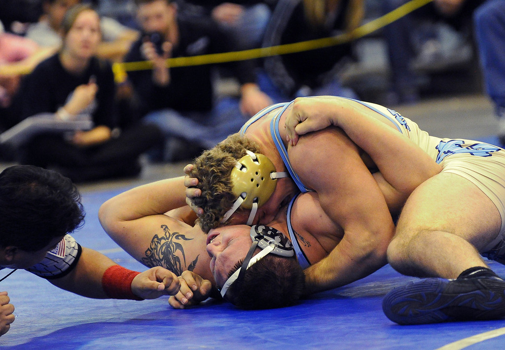 . Austin Waterman of Greeley West, top, won the 285 pound final match against Jorge Rodriguez of Mountain Range during  Northern Colorado Christmas Tournament at Island Grove Event Center in Greeley, Colo., on Saturday, Dec. 22, 2012. Hyoung Chang, The Denver Post