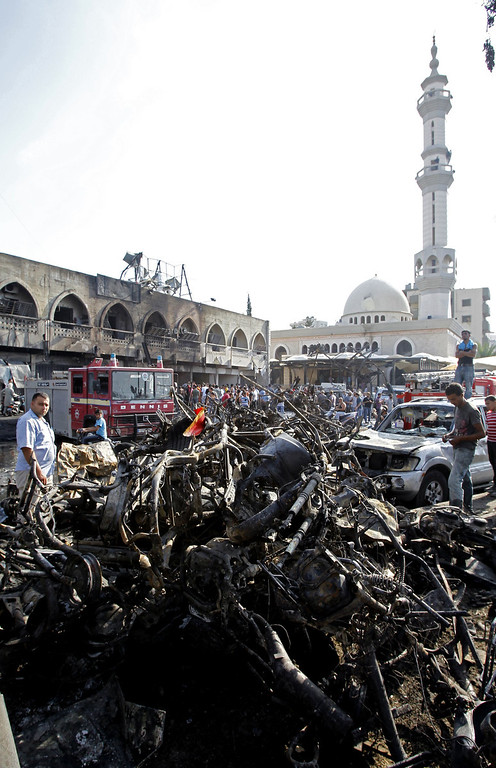 . A member of the Lebanese Red Cross inspects the site of a blast outside the Al-Taqwa mosque (background) in the northern city of Tripoli on August 23, 2013.  AFP PHOTO/ANWAR AMRO/AFP/Getty Images