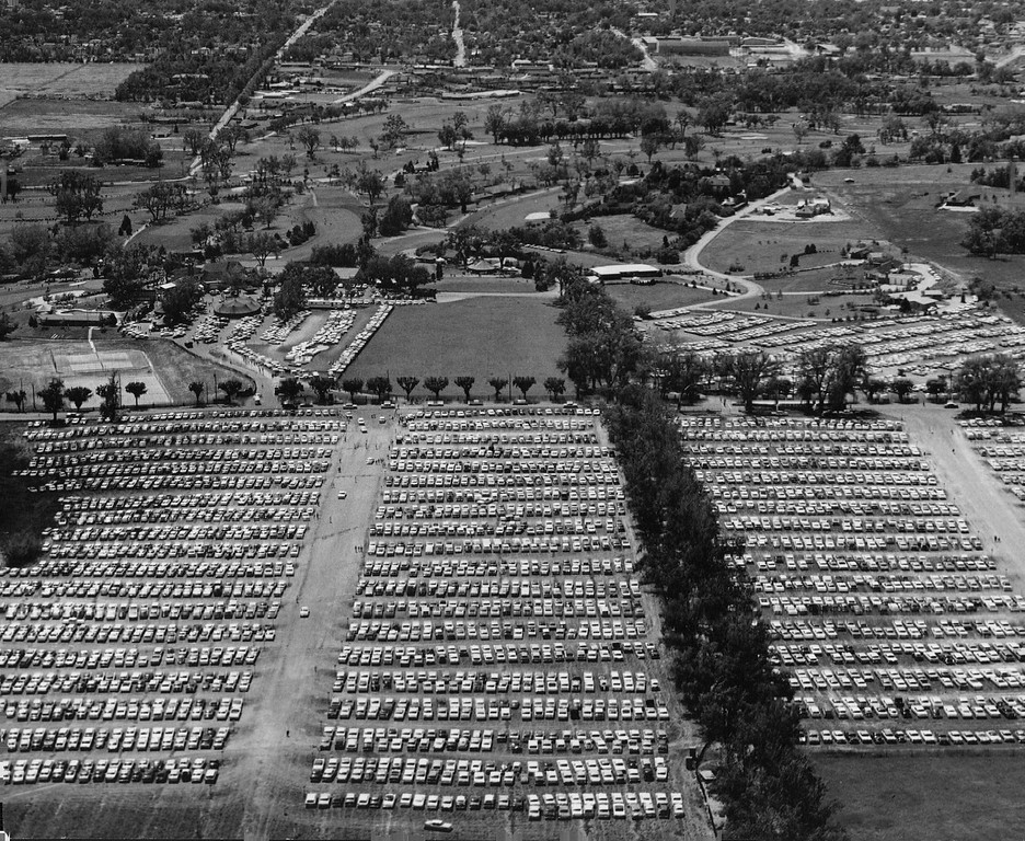 . The Eyes of the Golfing world were on Cherry Hills Country Club in 1960 during final round of the U.S. Open Golf championship. And the eyes of more than 15,000 fans were on the players themselves as they shot and trudged around the picturesque course.  In foreground are acres of parked cars that bore fans to this greatest of competitive golfing events. Denver Post Library photo archive
