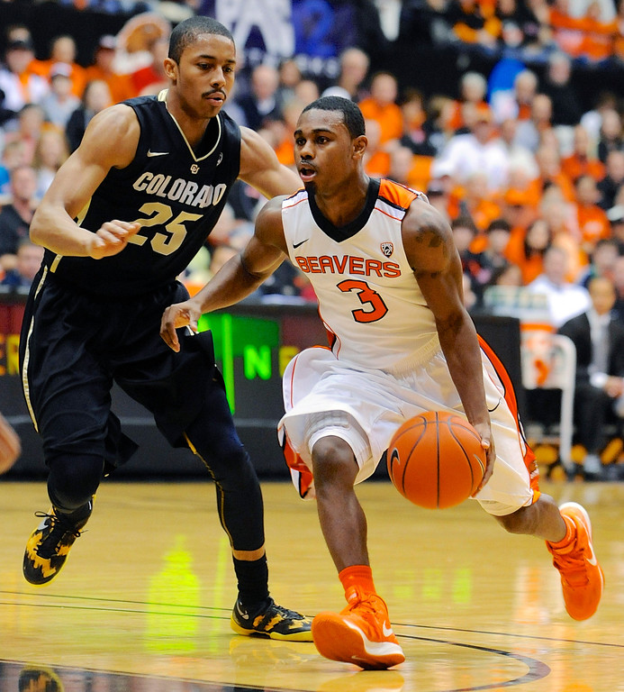 . Oregon State\'s Ahmad Starks (3) drives against Colorado\'s Spencer Dinwiddie (25) during the second half of an NCAA college basketball game in Corvallis, Ore., Sunday, Feb. 10, 2013. Colorado won 72-68. (AP Photo/Greg Wahl-Stephens)