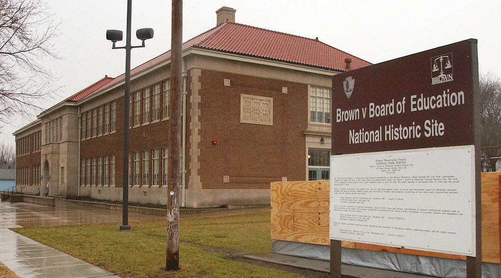 . FILE - This March 3, 2004 file photo shows the Brown v. Board of Education National Historic Site as work continues  in Topeka, Kansas. Saturday marks the 60th anniversary of the landmark Brown v. Board of Education decision. Many inequities in education still exist for black students and for Hispanics, a population that has grown exponentially since the 1954 ruling.   (AP Photo/Orlin Wagner, File)