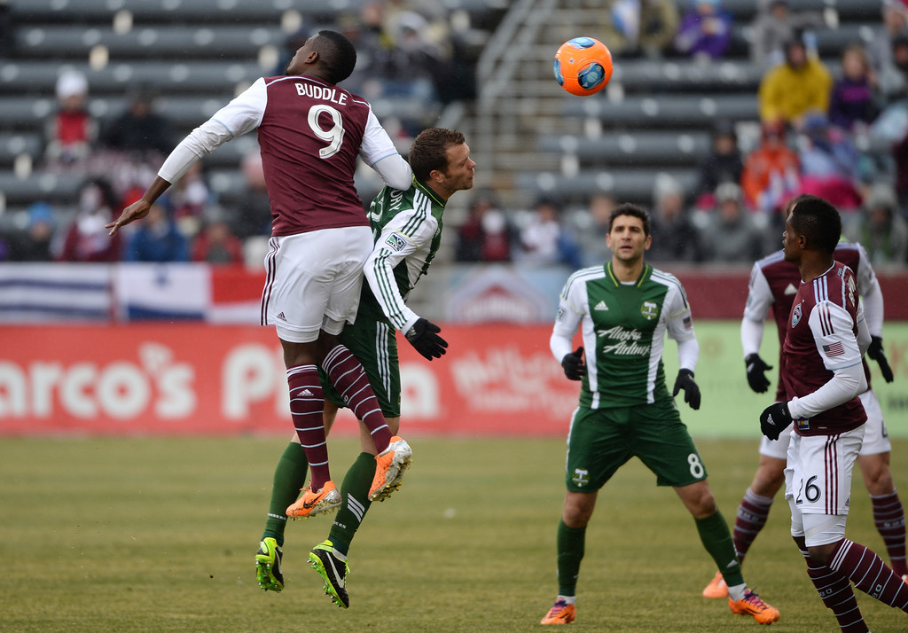 . COMMERCE CITY MARCH 22: From left, Edson Buddle of Colorado Rapids (9) and Alvas Powell of Portland Timbers (2) are fighting for the control of the ball in the 1st half of the game at Dick\'s Sporting Goods Park. Commerce City, Colorado. March 22. 2014. Colorado won 2-0. (Photo by Hyoung Chang/The Denver Post)
