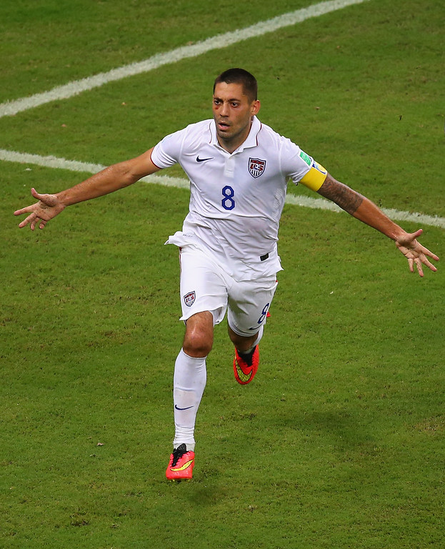 . Clint Dempsey of the United States celebrates after scoring his team\'s second goal during the 2014 FIFA World Cup Brazil Group G match between the United States and Portugal at Arena Amazonia on June 22, 2014 in Manaus, Brazil.  (Photo by Elsa/Getty Images)