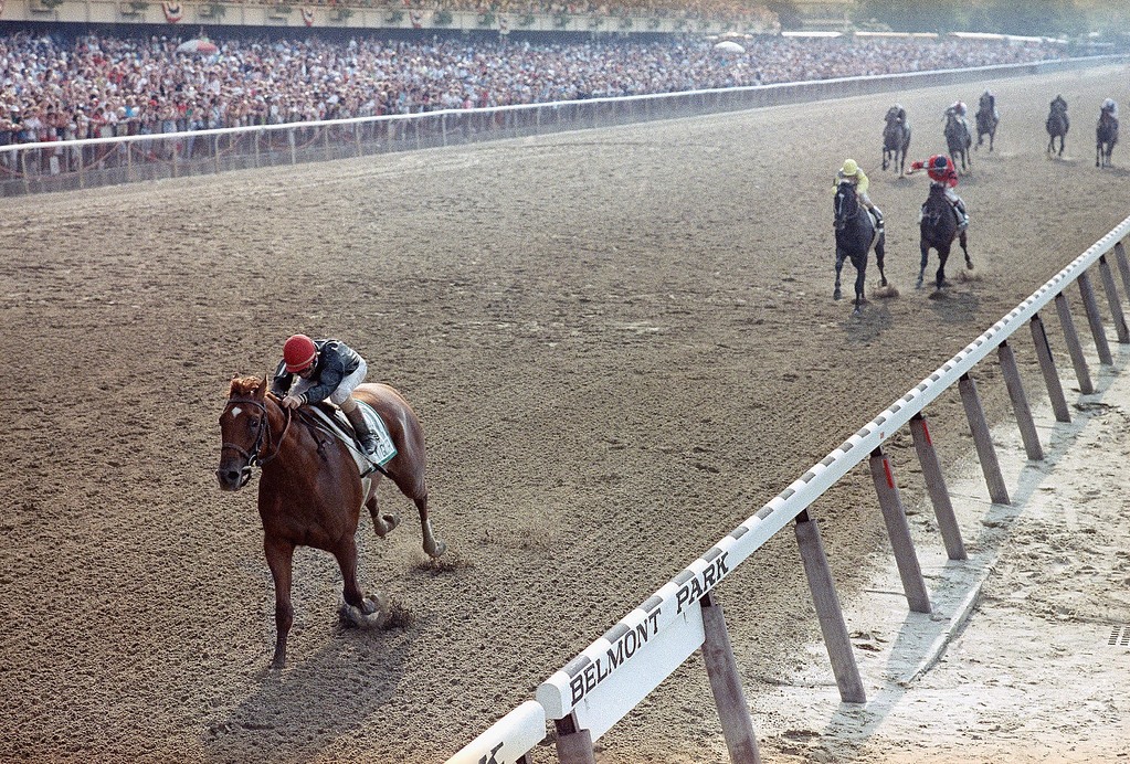 . Easy Goer, piloted by Pat Day, left, moves to an eight length finish ahead of Sunday Silence, second left, to win the Belmont Stakes Saturday, June 10, 1989.   Third left is third place finisher Le Vogageur at Belmont Park in New York. Sunday Silence won the Kentucky Derby and Prekness Stakes, but failed to complete the triple crown. (AP Photo/Mark Lennihan)