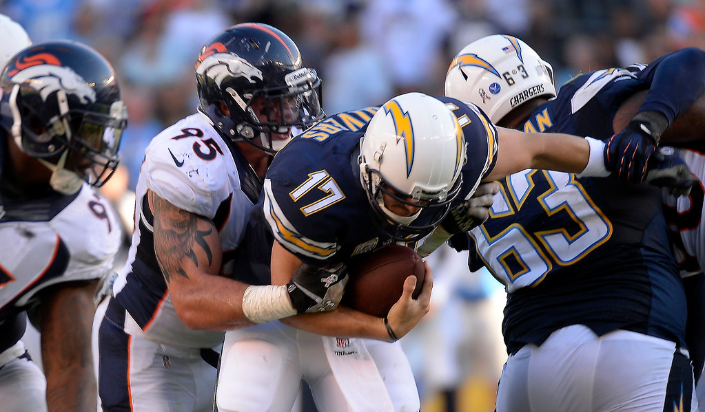 . Denver Broncos defensive end Derek Wolfe (95) sacked San Diego Chargers quarterback Philip Rivers (17) during the second quarter at Qualcomm Stadium. (Photo by John Leyba/The Denver Post)
