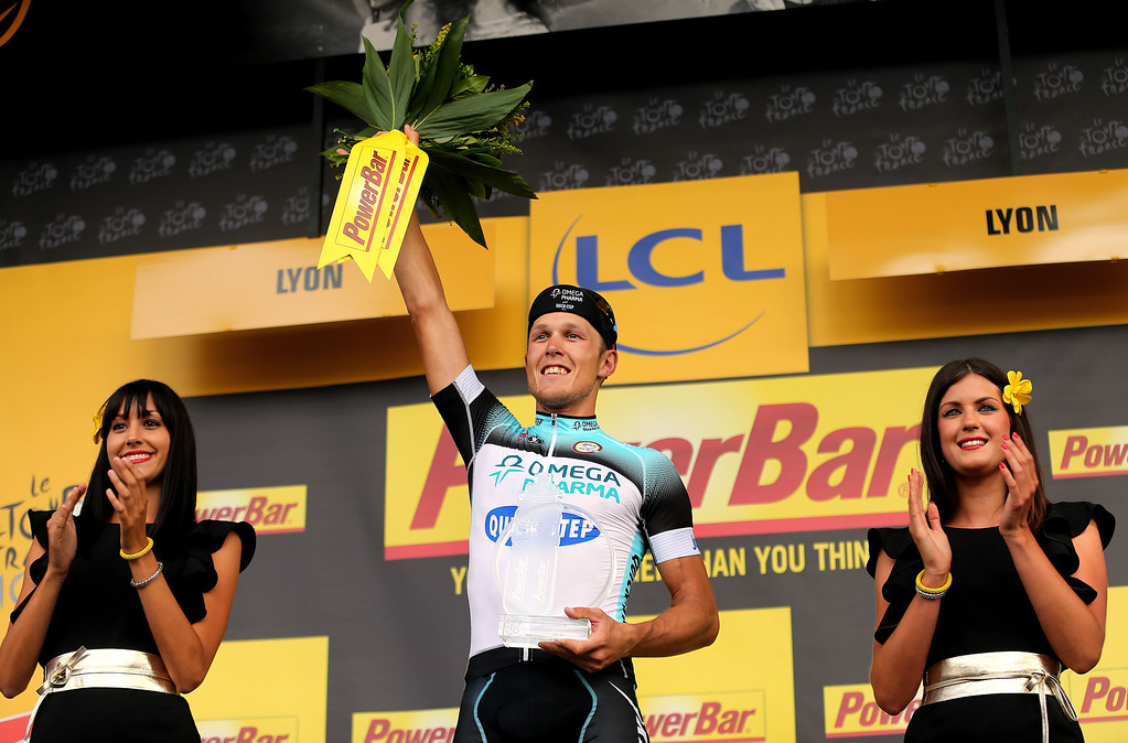 . LYON, FRANCE - JULY 13:  Matteo Trentin of Italy and Omega Pharma-Quickstep celebrates on the podium after winning stage fourteen of the 2013 Tour de France, a 191KM road stage from Saint-Pourcain-sur-Sioule to Lyon, on July 13, 2013 in Lyon, France.  (Photo by Bryn Lennon/Getty Images)