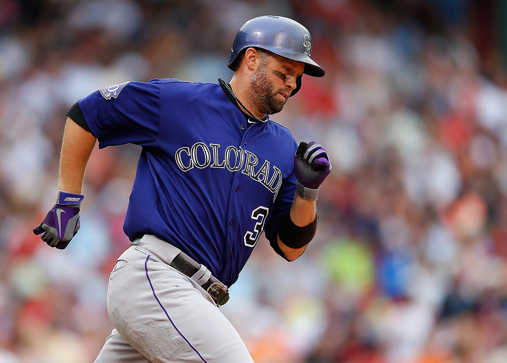 . Michael Cuddyer #3 of the Colorado Rockies rounds the bases after hitting a home run against John Lackey #41 of the Boston Red Sox at the plate in the 6th inning at Fenway Park on June 26, 2013 in Boston, Massachusetts.  (Photo by Jim Rogash/Getty Images)