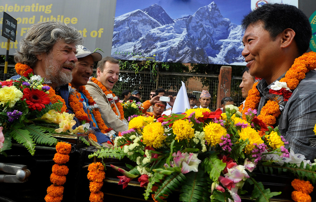 . Italian mountaineer Reinhold Messner (L), Nepalese mountaineer Phurba Tashi Sherpa (2nd L), and Migma Sherpa (R) sit in a horse-drawn carriage during a procession for Everest Summitteers during the Mount Everest Diamond Jubilee celebrations in Kathmandu on May 29, 2013. Messner was the first person to climb Everest without oxygen. Nepal marked 60 years since the first ascent of Everest May 29, celebrating the summiteers whose success has bred an industry that many climbers now fear is ruining the world\'s highest peak. PRAKASH MATHEMA/AFP/Getty Images