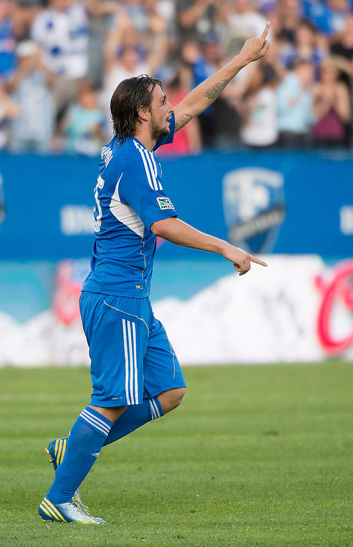 . Montreal Impact\'s Daniele Paponi celebrates his first-half goal against the Colorado Rapids in an MLS soccer game in Montreal on Saturday, June 29, 2013. (AP Photo/The Canadian Press, Peter McCabe)