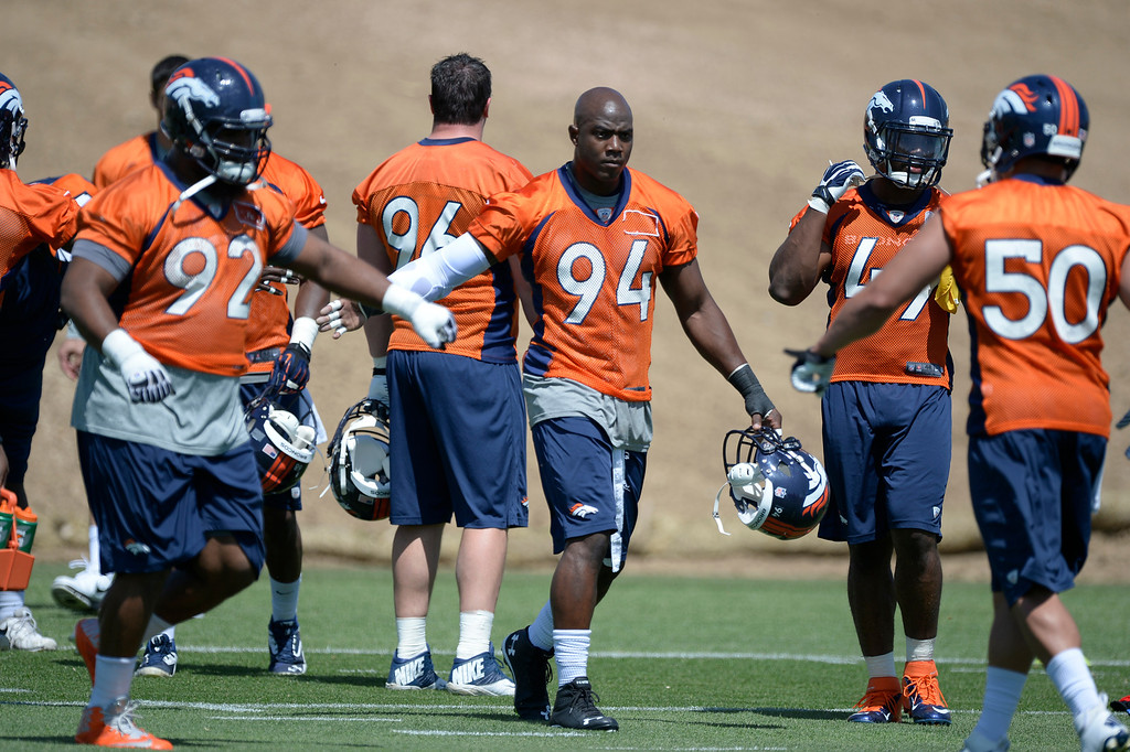 . Denver Broncos DeMarcus Ware (94) heads to drills during OTAs June 10, 2014 at Dove Valley. (Photo by John Leyba/The Denver Post)