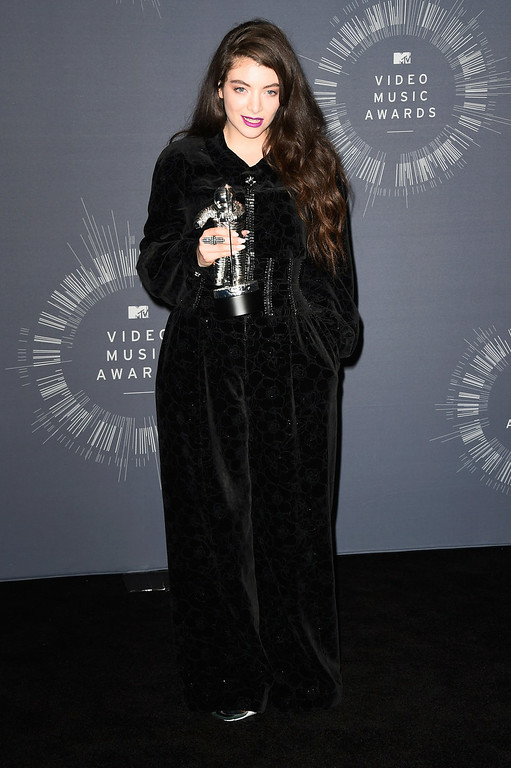 . Recording artist Lorde poses in the press room during the 2014 MTV Video Music Awards at The Forum on August 24, 2014 in Inglewood, California.  (Photo by Frazer Harrison/Getty Images)