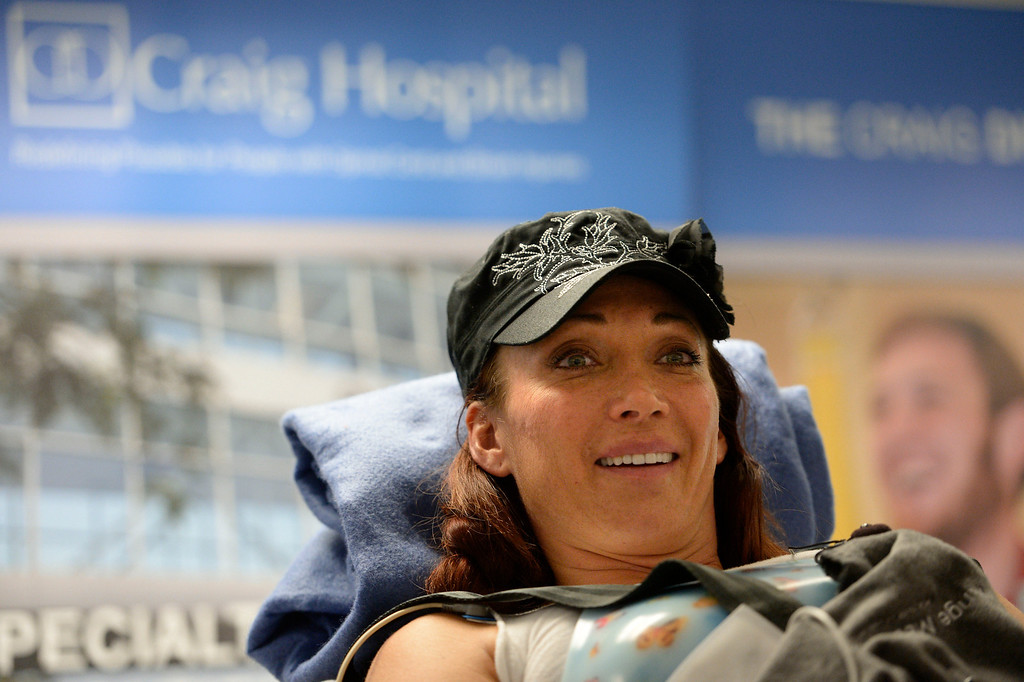 . Amy Van Dyken-Rouen addresses the media after she arrives at Craig Hospital after leaving Scottsdale Healthcare Osborne Medical Center June 18, 2014 by Angel MedFlight.  (Photo by John Leyba/The Denver Post)