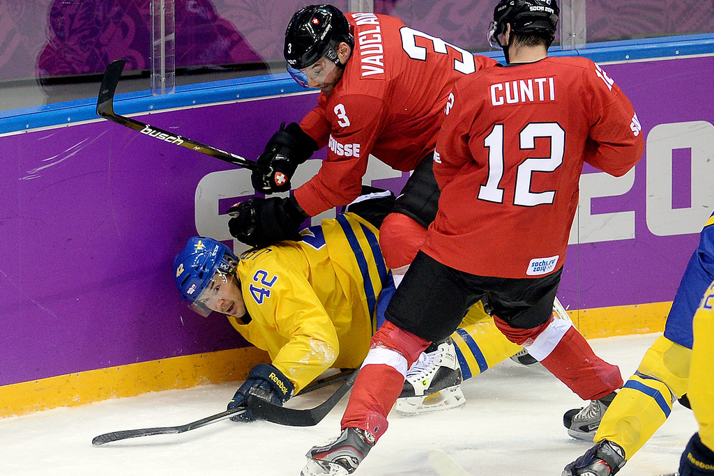 . Switzerland\'s Julien Vauclair holds Sweden\'s Jimmie Ericsson down during the action at Bolshoy Arena. Sochi 2014 Winter Olympics on Friday, February 14, 2014. (Photo by AAron Ontiveroz/The Denver Post)
