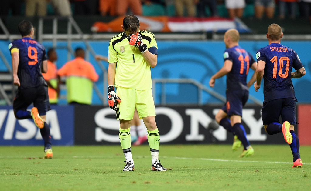 . Spain\'s goalkeeper Iker Casillas (C) reacts after Netherlands\' forward Robin van Persie (L) scored his team\'s fourth goal during a Group B football match between Spain and the Netherlands at the Fonte Nova Arena in Salvador during the 2014 FIFA World Cup on June 13, 2014. JAVIER SORIANO/AFP/Getty Images