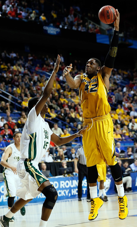. LEXINGTON, KY - MARCH 21:  Alex Oriakhi #42 of the Missouri Tigers shoots against Gerson Santo #15 of the Colorado State Rams during the second round of the 2013 NCAA Men\'s Basketball Tournament at the Rupp Arena on March 21, 2013 in Lexington, Kentucky.  (Photo by Kevin C. Cox/Getty Images)