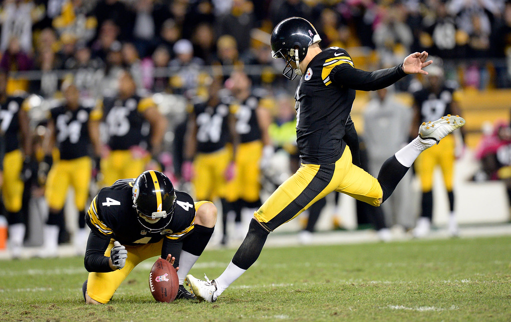 . Pittsburgh Steelers holder Zoltan Mesko (4) holds the ball as kicker Shaun Suisham kicks the winning field goal against the Baltimore Ravens in the fourth quarter of an NFL football game on Sunday, Oct. 20, 2013, in Pittsburgh. The Steelers won 19-16. (AP Photo/Don Wright)