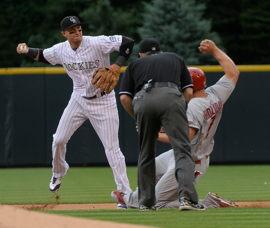 . Colorado Rockies shortstop Troy Tulowitzki (2) gets the force at second on St. Louis Cardinals left fielder Matt Holliday (7) during the first inning June 25, 2014 at Coors Field. Colorado Rockies shortstop Troy Tulowitzki (2) couldn\'t turn the double play.  (Photo by John Leyba/The Denver Post)
