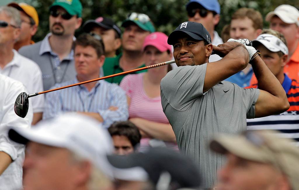 . Tiger Woods tees off on the 15th hole during the first round of the Masters golf tournament Thursday, April 11, 2013, in Augusta, Ga. (AP Photo/David J. Phillip)