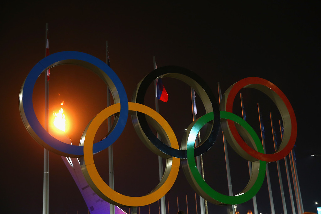 . The flame is seen through the Olympic Rings after the Opening Ceremony of the Sochi 2014 Winter Olympics at Fisht Olympic Stadium on February 7, 2014 in Sochi, Russia.  (Photo by Robert Cianflone/Getty Images)