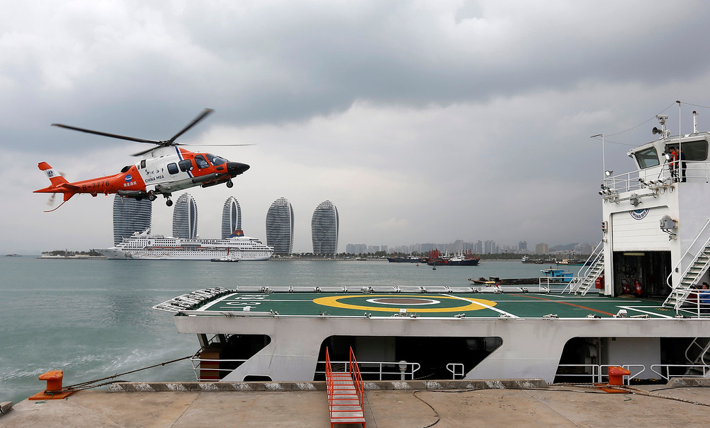 . A helicopter prepares to land onboard the China Maritime Safety Administration (MSA) ship Haixun-31 during a brief stop in Sanya in southern China\'s Hainan province Sunday March 9, 2014. The ship is expected to join an ongoing search for the missing Malaysian Airlines\' passenger plane that vanished on Saturday.(AP Photo)
