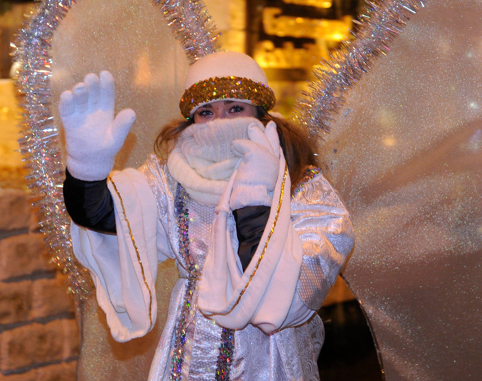 . DENVER, CO. - DECEMBER 06: An angel was bundled up for an appearance in a living nativity scene as the 9News Parade of Lights kicked off Friday night, December 6, 2013. The weather was clear but temperatures dipped below zero. Photo By Karl Gehring/The Denver Post