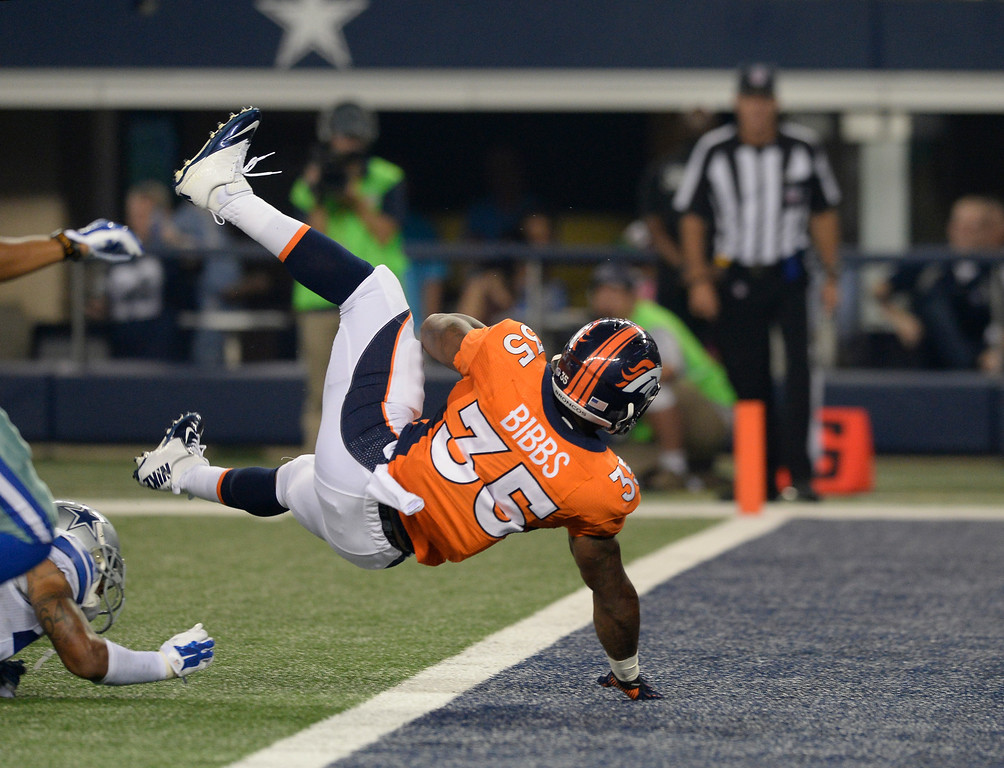 . ARLINGTON, TX - AUGUST 28: Denver Broncos running back Kapri Bibbs (35) flips in to th eendzone for touchdown against the Dallas Cowboys during the third quarter August 28, 2014 at AT&T Stadium. (Photo by John Leyba/The Denver Post)