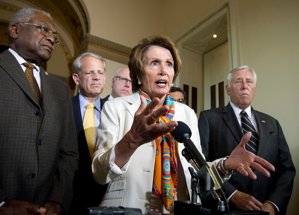 . House Minority Leader Nancy Pelosi of Calif., together with the Democratic leadership, gestures while speaking during a news conference on Capitol Hill in Washington, Monday, Sept. 30, 2013, to discuss the budget showdown. From left are, House Assistant Minority Leader James Clyburn of S.C., Rep. Steve Israel, D-N.Y., Pelosi, Rep. Joseph Crowley, D-N.Y., and House Minority Whip Steny Hoyer of Md.  (AP Photo/Manuel Balce Ceneta)