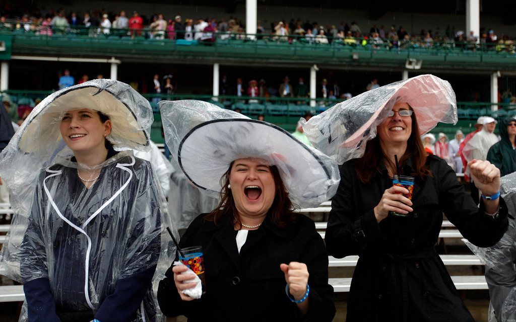 . From left, Amanda Dugan, Bernadette Osborne and Tracy Clay watch the fourth race before the 139th Kentucky Derby at Churchill Downs Saturday, May 4, 2013, in Louisville, Ky. (AP Photo/David Goldman)