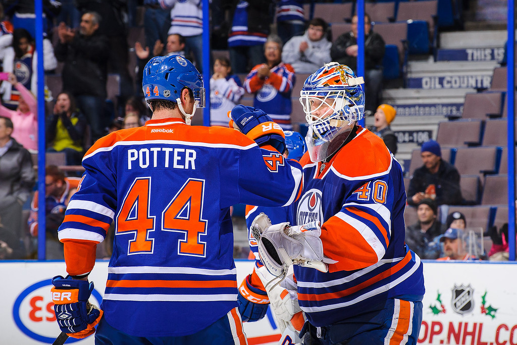 . EDMONTON, AB - DECEMBER 5: Corey Potter #44 (L) and Devan Dubnyk #40 (R) of the Edmonton Oilers celebrate after their victory over the Colorado Avalanche during an NHL game at Rexall Place on December 5, 2013 in Edmonton, Alberta, Canada. The Oilers defeated the Avalanche 8-2. (Photo by Derek Leung/Getty Images)