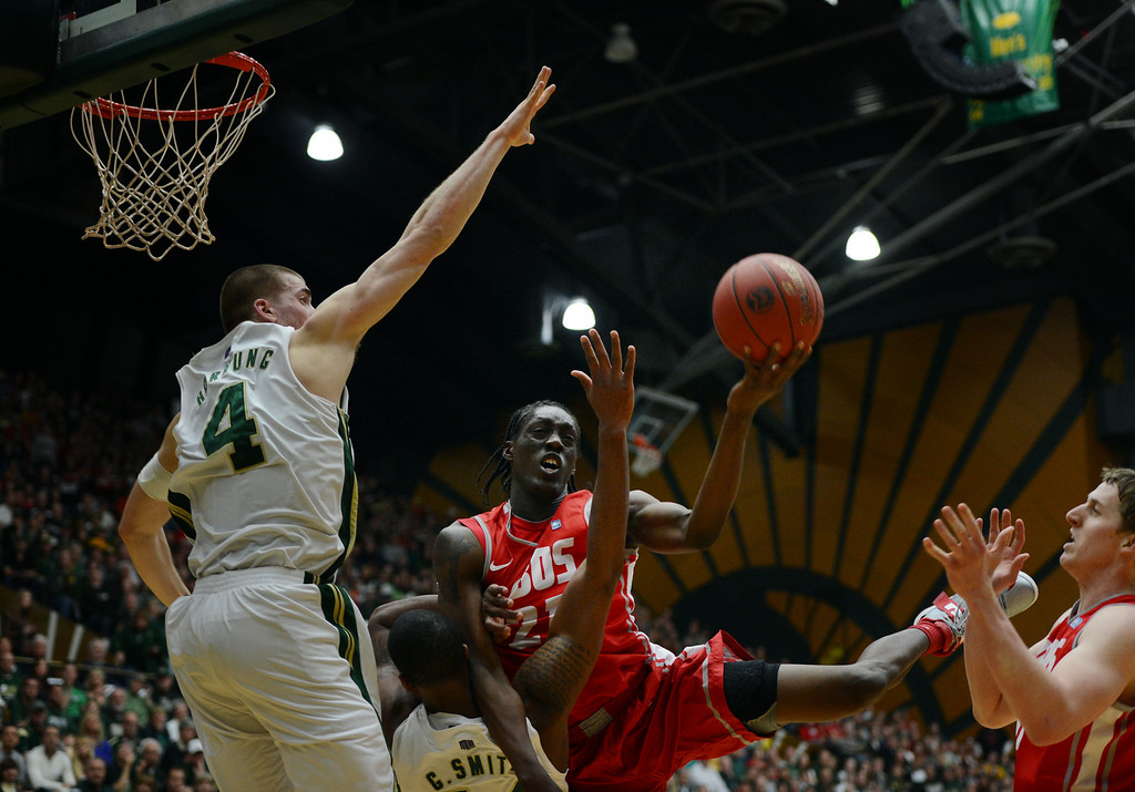 . Fort COLLINS, CO. - FEBRUARY 23: New Mexico Tony Snell drives to the basket against CSU Pierce Hornung and Greg Smith during first half action at Moby Arena in Fort Collin, CO February  24, 2013. The Colorado State Rams lost to the New Mexico Lobos 91-82. (Photo By Craig F. Walker/The Denver Post)