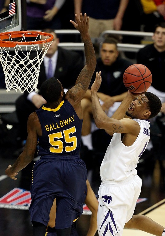 . KANSAS CITY, MO - MARCH 22: Shane Southwell #1 of the Kansas State Wildcats shoots against Ramon Galloway #55 of the La Salle Explorers in the second half during the second round of the 2013 NCAA Men\'s Basketball Tournament at the Sprint Center on March 22, 2013 in Kansas City, Missouri.  (Photo by Ed Zurga/Getty Images)