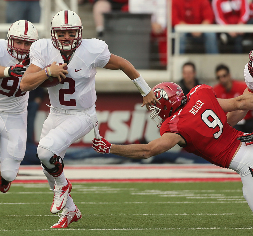 . SALT LAKE CITY, UT - OCTOBER 12: Dallas Lloyd #2 of the Stanford Cardinal takes off with the ball past Trevor Reilly #9 of the Utah Utes during the first half of an NCAA football game October 12, 2013 at Rice Eccles Stadium in Salt Lake City, Utah. (Photo by George Frey/Getty Images)