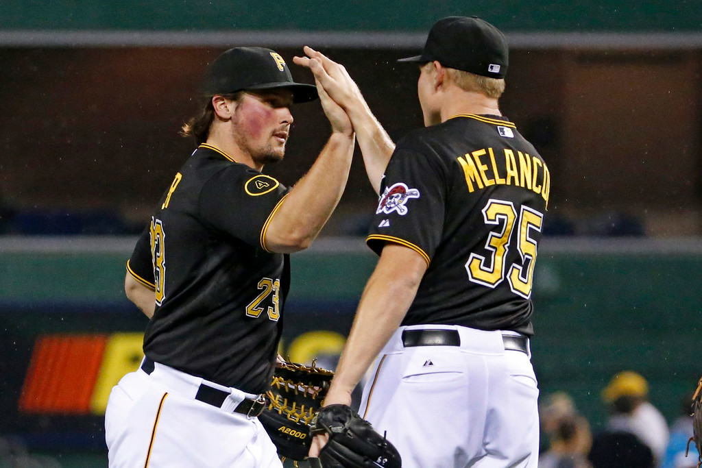 . Pittsburgh Pirates\' Travis Snider, left, celebrates with relief pitcher Mark Melancon (35) after the Pirates\' 4-2 win over the Colorado Rockies in a baseball game in Pittsburgh on Friday, July 18, 2014. (AP Photo/Gene J. Puskar)