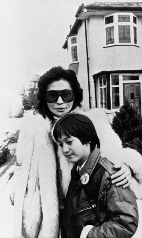 . Yoko Ono, widow of the late John Lennon, left, with her eight-year old son Sean outside Lennons childhood home at 251 Menlove Avenue, when the two made an emotional tour of the ex-Beatles home town, Tuesday, Jan. 24, 1984, Liverpool, England. (AP Photo/Mercury)
