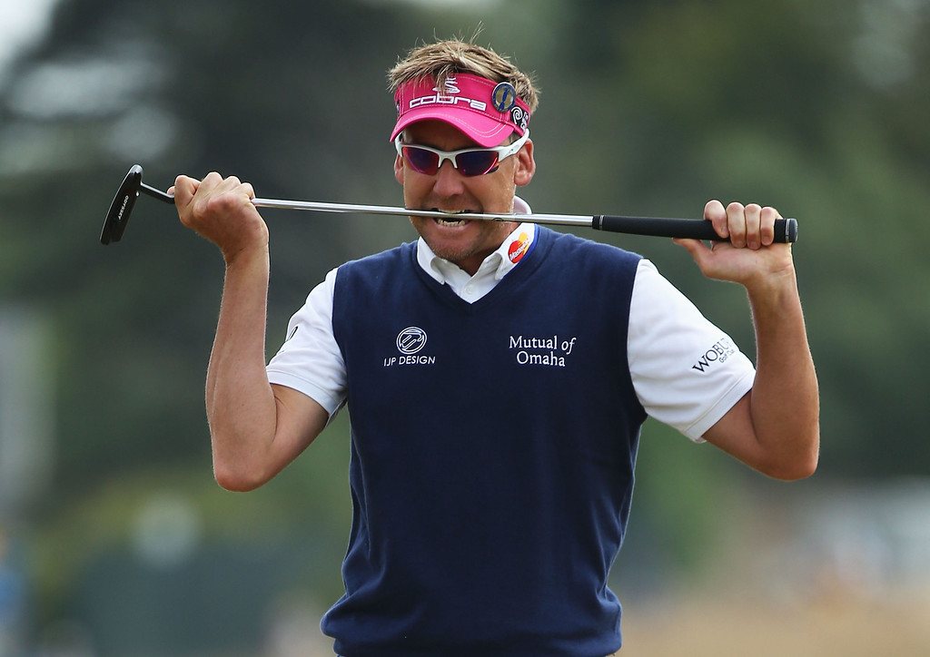 . Ian Poulter of England bites his putter after missing a birdie putt on the 1st green during the final round of the 142nd Open Championship at Muirfield on July 21, 2013 in Gullane, Scotland.  (Photo by Andy Lyons/Getty Images)
