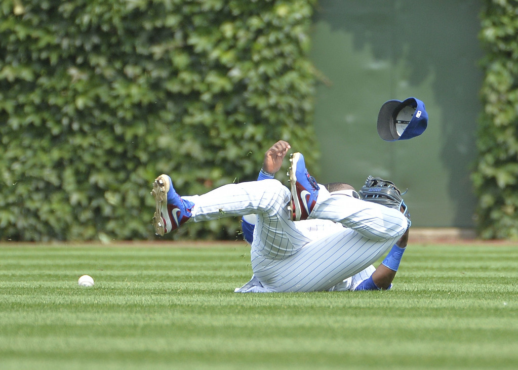 . Center fielder Junior Lake #21 of the Chicago Cubs fails to catch a single hit by Wilin Rosario #20 of the Colorado Rockies during the fifth inning at Wrigley Field on July 31, 2014 in Chicago, Illinois.  (Photo by Brian Kersey/Getty Images)