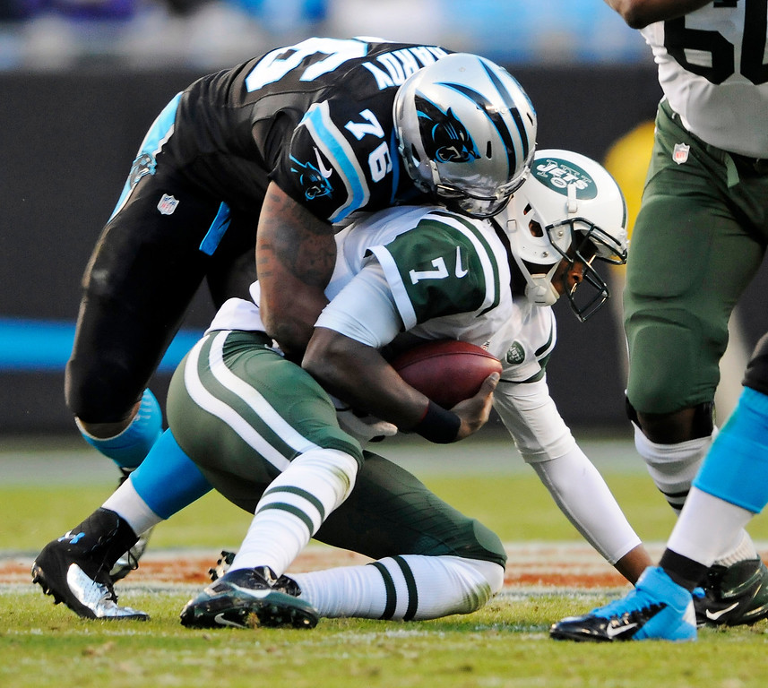 . New York Jets\' Geno Smith (7) is sacked by Carolina Panthers\' Greg Hardy (76) during the first half of an NFL football game in Charlotte, N.C., Sunday, Dec. 15, 2013. (AP Photo/Mike McCarn)