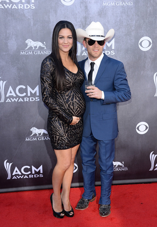 . Singer/songwriter Justin Moore (R) and wife Kate Moore attend the 49th Annual Academy Of Country Music Awards at the MGM Grand Garden Arena on April 6, 2014 in Las Vegas, Nevada.  (Photo by Jason Merritt/Getty Images)