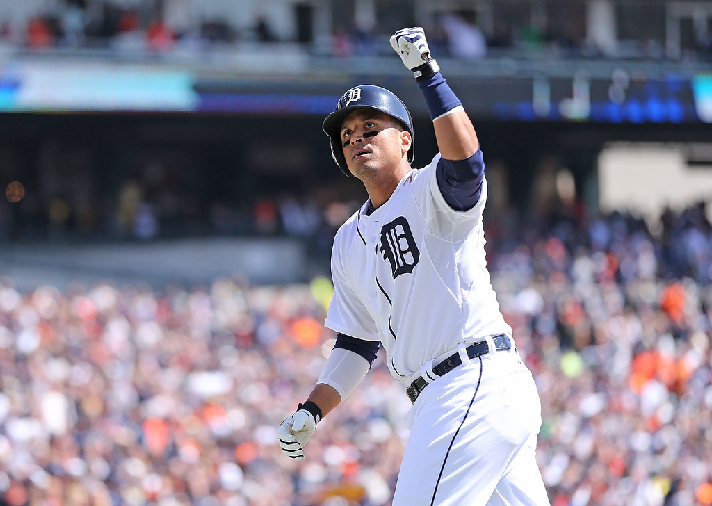 . Victor Martinez #41 of the Detroit Tigers celebrates after hitting a solo home run during the second inning of the Opening Day game against the Kansas City Royals at Comerica Park on March 31, 2014 in Detroit, Michigan.  (Photo by Leon Halip/Getty Images)