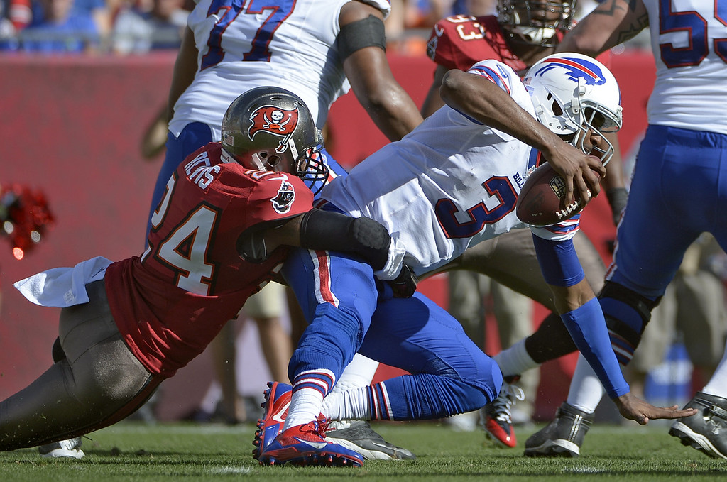 . Tampa Bay Buccaneers cornerback Darrelle Revis (24) sacks Buffalo Bills quarterback EJ Manuel (3) during the second quarter of an NFL football game on Sunday, Dec. 8, 2013, in Tampa, Fla. (AP Photo/Phelan M. Ebenhack)