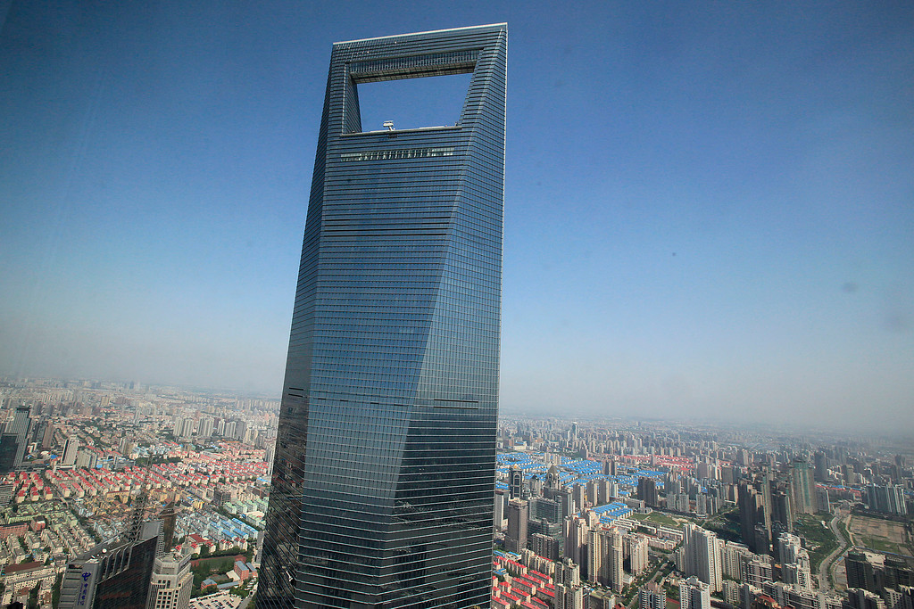 . This June 25, 2009 file photo shows the Shanghai World Financial Center in Shanghai, China. According to the nonprofit Council on Tall Buildings and Urban Habitat, the Shanghai World Financial Center will be the fifth tallest completed building in the world with the height measured at 1,614 feet, once New York\'s 1 World Trade Center, with a height of 1,776 feet, is completed. (AP Photo/Eugene Hoshiko, File)