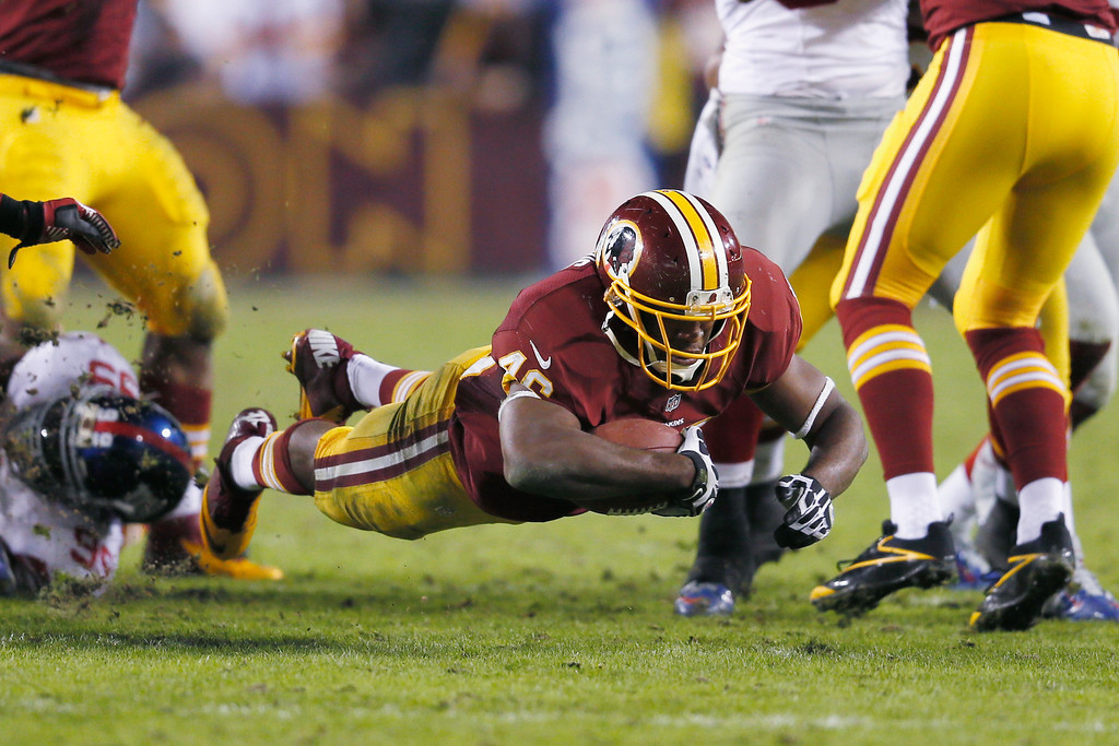 . LANDOVER, MD - DECEMBER 03: Running back Alfred Morris #46 of the Washington Redskins dives for a first down during the closing moments of the Redskins 17-16 win over the New York Giants at FedExField on December 3, 2012 in Landover, Maryland.  (Photo by Rob Carr/Getty Images)