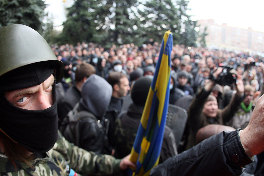 . A masked pro-Russia activists looks on during a pro-Russia rally outside the regional police building in the eastern Ukrainian city of Horlivka (Gorlovka), near Donetsk, on April 14, 2014. AFP PHOTO/ ALEXANDER KHUDOTEPLY/AFP/Getty Images
