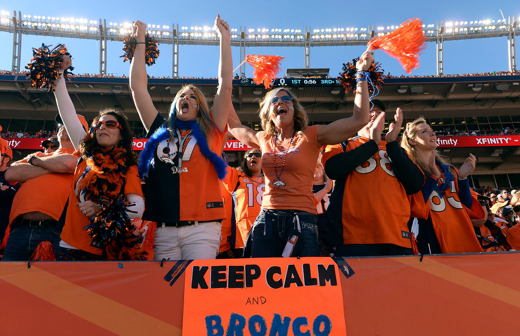 . Broncos fans cheer on their team during the first quarter.  The Denver Broncos vs. The New England Patriots in an AFC Championship game  at Sports Authority Field at Mile High in Denver on January 19, 2014. (Photo by Helen Richardson/The Denver Post)