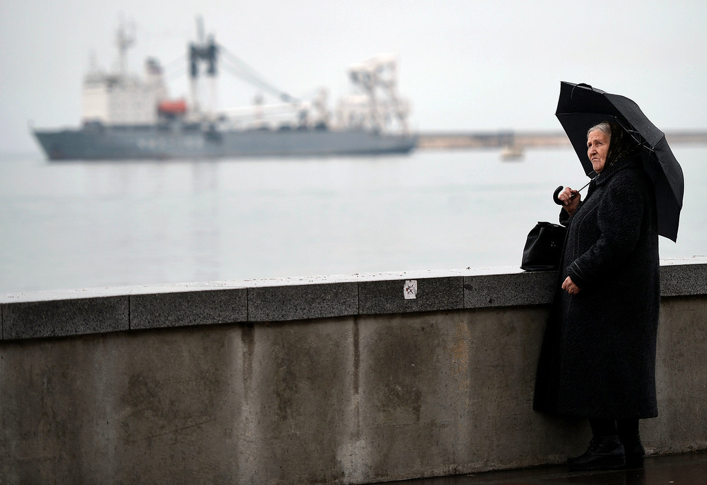 . A woman stares at the sea from the Sevastopol harbour on March 4, 2014. The Russian Black Sea Fleet commander Aleksandr Vitko has issued an ultimatum to the Ukrainian military personnel in Crimea, the Interfax-Ukraine news agency reported. Ukraine accused Russia on March 3 of pouring more troops into Crimea as world leaders grappled with Europe\'s worst standoff since the Cold War and the Moscow market plunged on fears of an all-out conflict  AFP PHOTO/Filippo MONTEFORTE/AFP/Getty Images