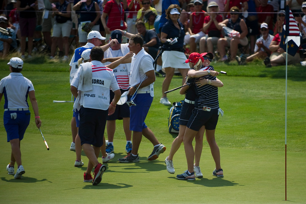 . PARKER, CO - AUGUST 16: American Jessica Korda celebrates with teammate Morgan Pressel after sinking a long putt after recovering from a penalty to win their match on the sixteenth hole during the first day of the Solheim Cup at Colorado Golf Club, on August 16, 2013.  (Photo By Grant Hindsley/The Denver Post)