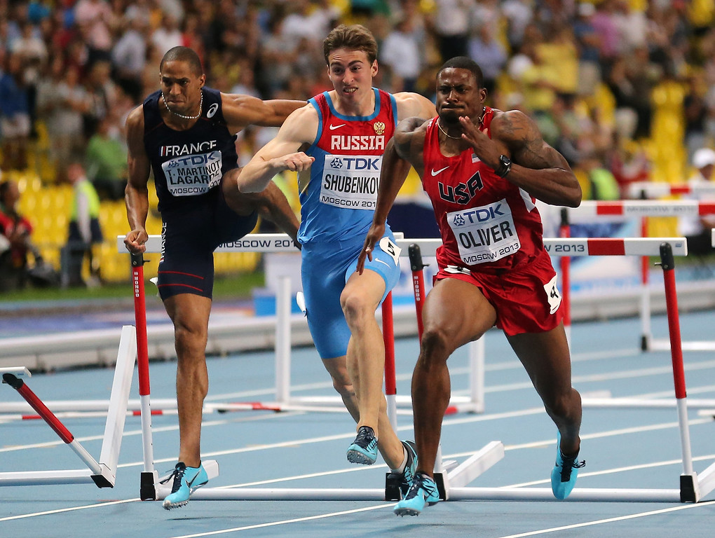 . David Oliver of the United States and Sergey Shubenkov of Russia compete  in the Men\'s 110 meters hurdles final during Day Three of the 14th IAAF World Athletics Championships Moscow 2013 at Luzhniki Stadium on August 12, 2013 in Moscow, Russia.  (Photo by Ian Walton/Getty Images)