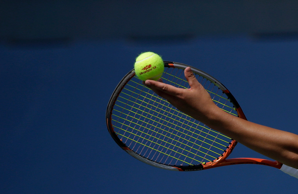 . Su-Wei Hsieh, of Taiwan, serves to Klara Zakopalova of the Czech Republic during the first round of the 2013 U.S. Open tennis tournament Tuesday, Aug. 27, 2013, in New York. (AP Photo/David Goldman)